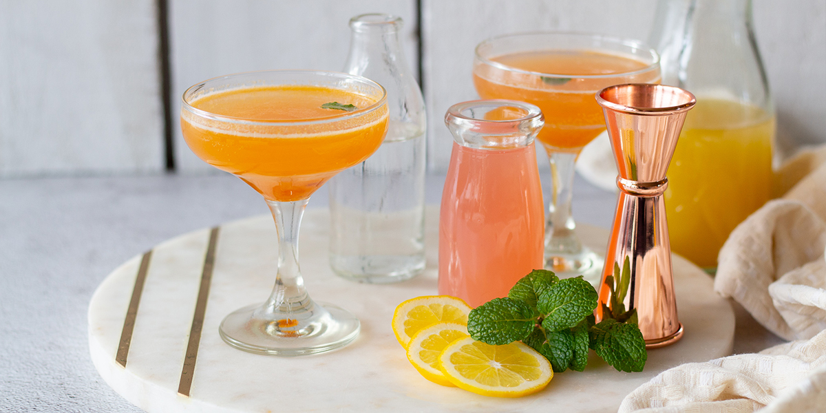 Two martini glasses with Apricot Delight mocktail